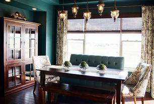 Contemporary Dining Room with High ceiling, can lights, double-hung window, Hardwood floors, Pendant light