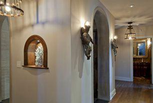 Eclectic Hallway with Built-in bookshelf, Wall sconce, Hardwood floors, flush light