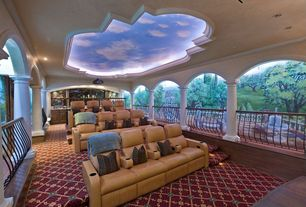 Mediterranean Home Theater with Mural, Carpet, Crown molding, Columns