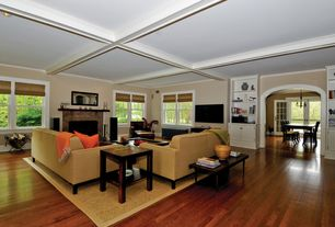 Traditional Living Room with Built-in bookshelf, Hardwood floors, Exposed beam, Crown molding