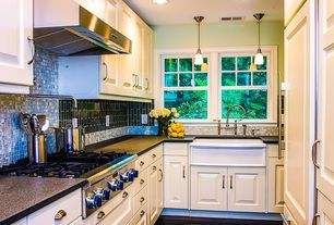 Traditional Kitchen with European Cabinets, electric cooktop, Flat panel cabinets, Galley, Built In Panel Ready Refrigerator
