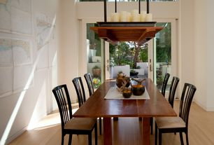 Contemporary Dining Room with Laminate floors, Chandelier, French doors