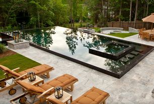 Contemporary Swimming Pool with Fence, Lap pool, exterior stone floors