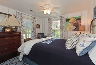 Cottage Guest Bedroom with Ceiling fan, Crown molding, Hardwood floors