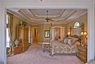 Traditional Master Bedroom with French doors, Ceiling fan, Crown molding, Arched window, Carpet