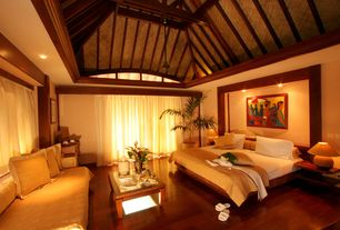 Tropical Master Bedroom with can lights, Exposed beam, High ceiling, Laminate floors