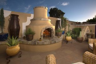 Mediterranean Patio with Fence, exterior stone floors, European terra cotta tile flooring, Bird bath