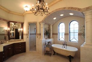 Mediterranean Master Bathroom with Stone Tile, Maxim Lighting Tenor 9 Light Multi Tier Chandelier, Clawfoot, Limestone Tile