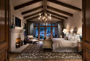 Craftsman Master Bedroom with Transom window, Bunny williams home turquoise table lamp, Chandelier, Exposed beam