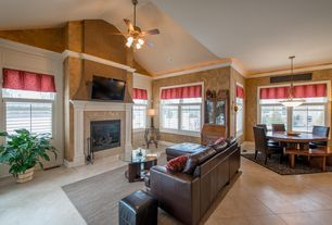 Traditional Great Room with High ceiling, stone fireplace, sandstone tile floors, Wall sconce, Ceiling fan, Pendant light