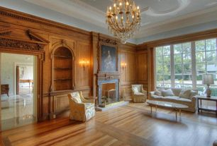 Traditional Living Room with stone fireplace, Chandelier, Wall sconce, Crown molding, Interlude home ashyln coffee table