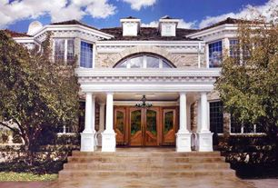 Entryway with Arched window, Concrete floors, Glass panel door, High ceiling, Columns, Casement