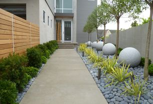 Contemporary Landscape/Yard with exterior tile floors, Fence, Raised beds, French doors, Pathway