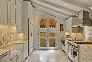 "Traditional Kitchen with Complex marble counters, Panel ready 36"" built-in bottom-freezer refrigerator, Stone Tile, U-shaped"