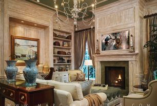 Traditional Living Room with High ceiling, Tufted velvet ottoman, Cement fireplace, Paint, Built-in bookshelf, can lights
