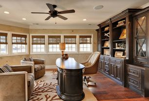 Traditional Home Office with Hardwood floors, Built-in bookshelf, Ceiling fan, Crown molding