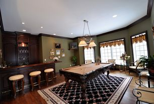 Traditional Game Room with Pendant light, Hardwood floors, Crown molding, Built-in bookshelf