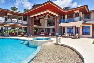 Tropical Swimming Pool with Pathway, picture window, French doors, exterior stone floors, Other Pool Type, Deck Railing