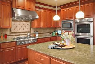 Traditional Kitchen with Inset cabinets, Complex granite counters, Standard height, Stone Tile, full backsplash, Raised panel