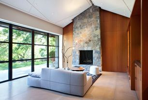 Contemporary Living Room with High ceiling, Built-in bookshelf, French doors, Concrete tile , stone fireplace