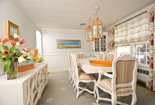 Eclectic Dining Room with double-hung window, Crown molding, Pendant light, Standard height, can lights, Chair rail