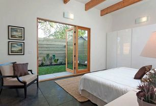 Contemporary Master Bedroom with French doors, Wall sconce, High ceiling, Concrete floors, Exposed beam