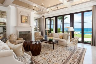 Traditional Living Room with Fireplace, Standard height, French doors, Chandelier, picture window, simple marble floors