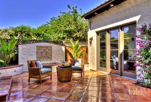 """Eclectic Patio with Marazzi super saltillo: desierto 12"""" x 12"""" porcelain tile, Fence, exterior terracotta tile floors"""