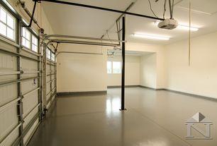Contemporary Garage with specialty door, Concrete floors, Columns, flush light