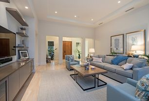 Contemporary Living Room with Built-in bookshelf, Columns, Standard height, can lights, Laminate floors