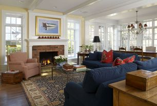 Traditional Great Room with Crown molding, brick fireplace, double-hung window, Birch Lane Newton Sofa, can lights, Fireplace