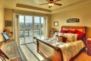 Mediterranean Guest Bedroom with Standard height, Ceiling fan, sliding glass door, Carpet
