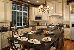 Traditional Kitchen with Built In Refrigerator, full backsplash, Breakfast bar, dishwasher, can lights, electric cooktop