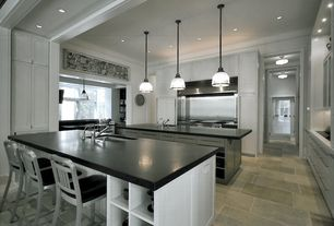 "Contemporary Kitchen with U-shaped, Corian Deep Nocturne, Undermount sink, Crate & Barrel Delta 24"" Aluminum Counter Stool"