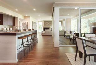 Contemporary Great Room with Columns, Built-in bookshelf, Hardwood floors