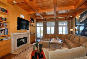 Craftsman Living Room with French doors, Wall sconce, Exposed beam, Hardwood floors, Built-in bookshelf, stone fireplace