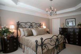 Traditional Master Bedroom with Built-in bookshelf, Carpet, Chandelier, Crown molding