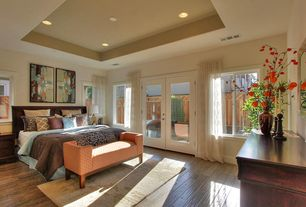 Contemporary Master Bedroom with Hardwood floors, French doors