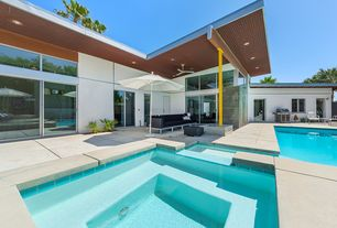 Modern Swimming Pool with exterior tile floors