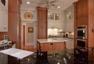 Traditional Kitchen with Inset cabinets, Ceramic Tile, Glass panel, Complex granite counters, Crown molding, High ceiling