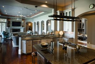 Contemporary Kitchen with Simple granite counters, Track lighting, Pergo Presto, Gunstock Oak Laminate Flooring, Ceiling fan