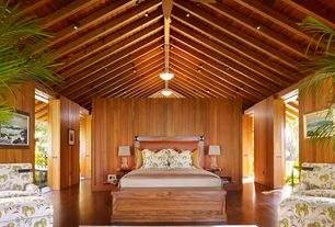 Tropical Master Bedroom with Exposed beam, flush light, Hardwood floors, Columns, Pendant light, Cathedral ceiling
