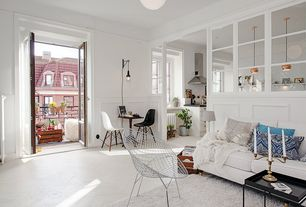 Eclectic Living Room with Concrete floors, flush light, French doors, Wainscotting