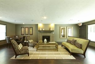 Contemporary Living Room with stone fireplace, Hardwood floors, Worlds Away Winston Gold Leafed Coffee Table