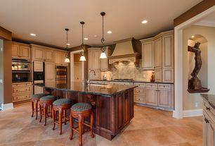 Traditional Kitchen with Undermount sink, Flat panel cabinets, Custom hood, Stone Tile, Simple granite counters, L-shaped