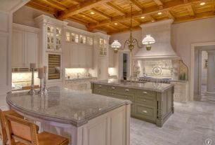 Traditional Kitchen with Breakfast bar, Pendant light, Glass panel, limestone tile floors, Flush, L-shaped, Undermount sink