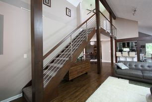 Contemporary Staircase with Floating staircase, Hardwood floors, Columns, High ceiling