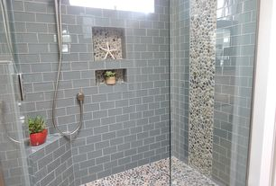 Contemporary 3/4 Bathroom with frameless showerdoor, Natural green pebble tile, Handheld showerhead