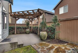 Traditional Landscape/Yard with exterior concrete tile floors, French doors, Trellis, Pathway, exterior stone floors, Fence