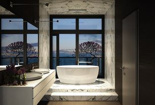 Contemporary Master Bathroom with Amaze oval bathtub, Corian counters, High ceiling, Double sink, Vessel sink, Freestanding